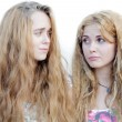 Two 20-24 years confused blond girls looking at each other — Stock Photo