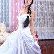 Beauty young bride dressed in... — Stock Photo