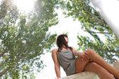 Happy beautiful young woman sitting — Stock Photo