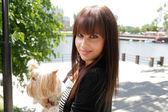 Beautiful woman holding small dog — Stock Photo
