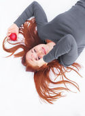 Red Hair with apple — Stockfoto