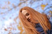 Close-up portrait of a beautiful red-headed girl posing — Stock Photo