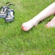 Perfect Feet in the sun with shaved legs on a meadow — Stock Photo #13607902