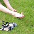 Perfect Feet in the sun with shaved legs on a meadow — Stock Photo #13607906