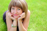 Beautiful woman on the grass — Stock Photo