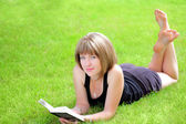 Outdoor picture of lovely student girl with book — Stock Photo