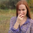 Beautiful young redhead in a autumn meadow — Stock Photo