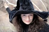 Lady in black witch hat headshot closeup — Stock Photo
