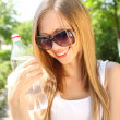Стоковое фото: Portrait of beautiful smiling girl outdoors