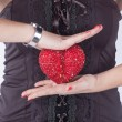 Red heart in woman's hands - Stock Photo