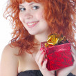 Pretty red haired girl with giftbox — Stock Photo
