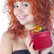 Stock Photo: Pretty red haired girl with giftbox