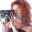 Beautiful female with camera — Stock Photo