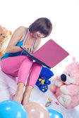 Young girl using a laptop — Stock Photo