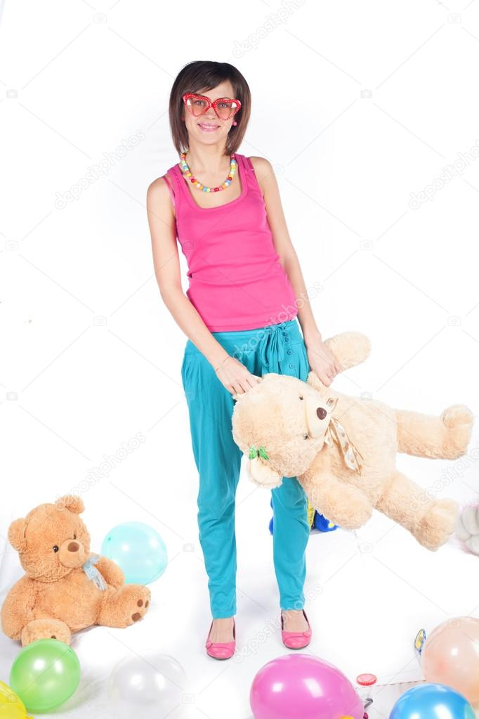 A beautiful and sexy 20-25 years brunette girl with teddy bear on white background — Stock Photo #19259921
