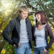 Stock Photo: Couple in love in the park on green