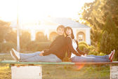 Happy smiling couple against sun lite — Stock Photo