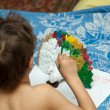 Portrait of little boy painting — Stock Photo