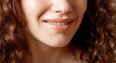 Close up shoot of young girl: Smiling Lips. — Stock Photo