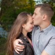 Stock Photo: Young couple in love kissing