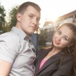 Couple in backlit at sunset in town — Stockfoto