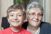 Portrait of a senior woman and grandson — Stock Photo