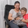 Mother and son with cat — Stock Photo #29434097