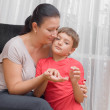Mother with her son on chair — Stock Photo #29434427