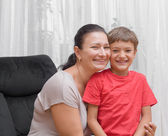 Happy mom and son hugging laughing — Stock Photo