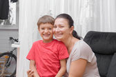 Happy mother and son smiling at home — Stock Photo