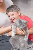 Mother and son with cat having fun. — Stock Photo