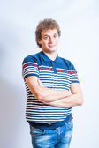 Man in stripped polo shirt — Stock Photo
