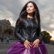 Sexy brunette outdoors weared black leather jacket and ballet tutu-skirt violet color — Stock fotografie