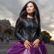 Sexy brunette outdoors weared black leather jacket and ballet tutu-skirt violet color — Stockfoto