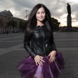 Sexy brunette outdoors weared black leather jacket and ballet tutu-skirt violet color — Stock Photo #31484117