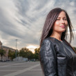Russian brunette 20s years old posing outdoors weared black leather jacket — Stock Photo