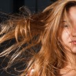 Half of a girl on a windy day, hair fly in the air — Stock Photo