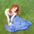 Meditating on grass redhead — Stock Photo
