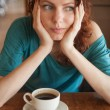 Redhead women sitting in the cafee with cup of coffee — Stock Photo