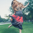Girl jumping like flying bird — Stock Photo