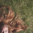 Woman relaxes on the grass — Stock Photo