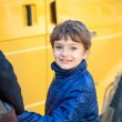 Portrait of happy kid looking back at camera on his way to school — Stok fotoğraf