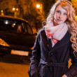 Young blond woman walking on the street — Stok fotoğraf