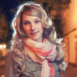 Portrait of a young female businesswoman in night city. Close-up, shallow DOF. — Stock Photo