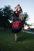 Young women make jump outdoors at evening — Zdjęcie stockowe