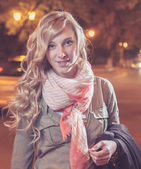 Portrait of a young businesswoman in night city. — Stock Photo