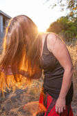 Young Woman In The Autumn at Sunset Back light — Stock Photo