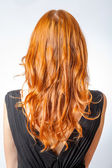 Back view of Red curly long hair Beautiful Woman — Stock Photo