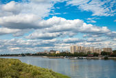 Sky,river, town,clouds — Stock Photo
