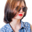 Stock Photo: Retro glasses girl closeup